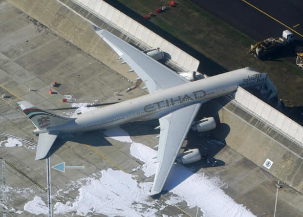 commercial airplane veered to the side of a runway