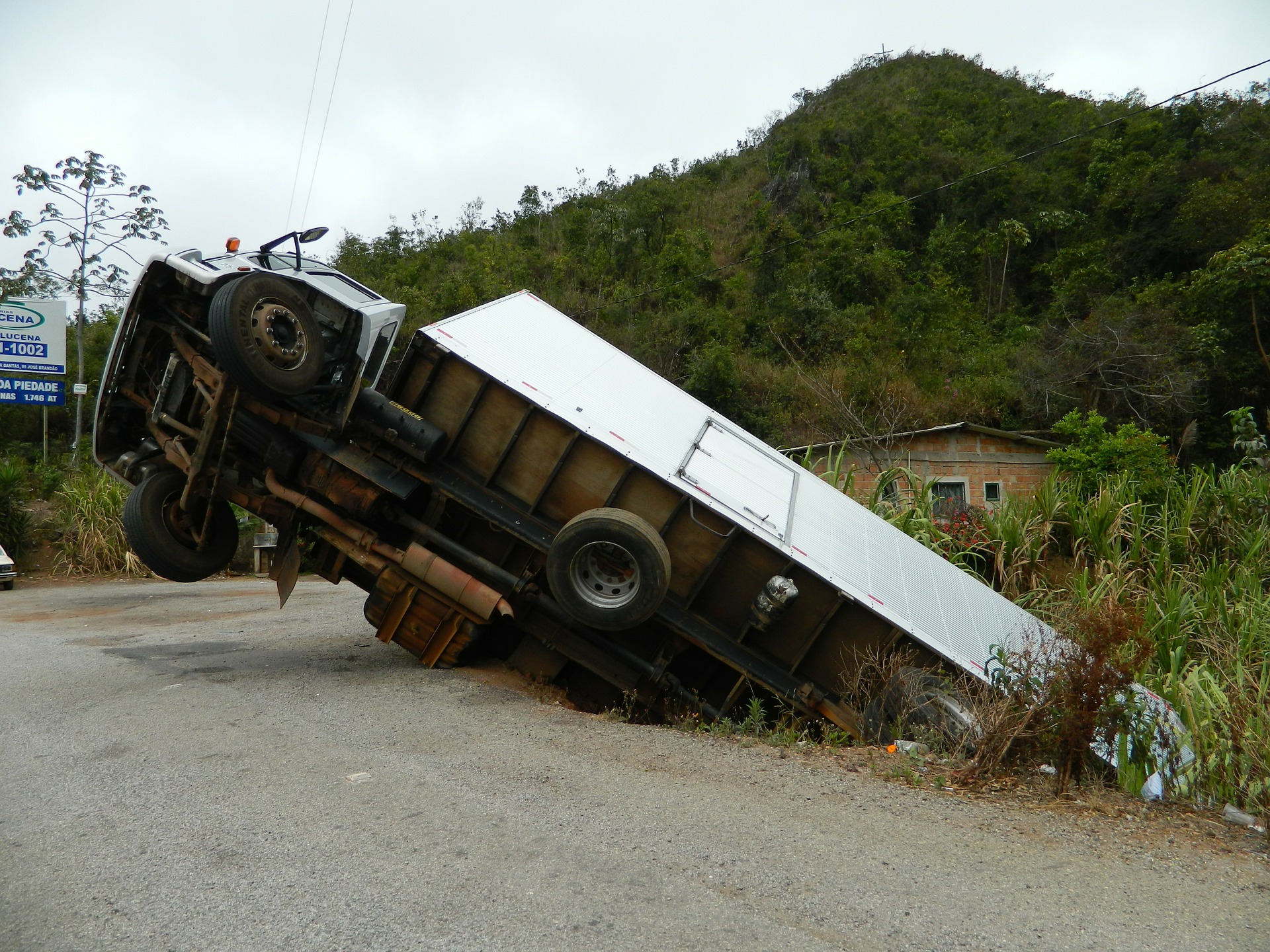 back end of a truck stuck on a ditch