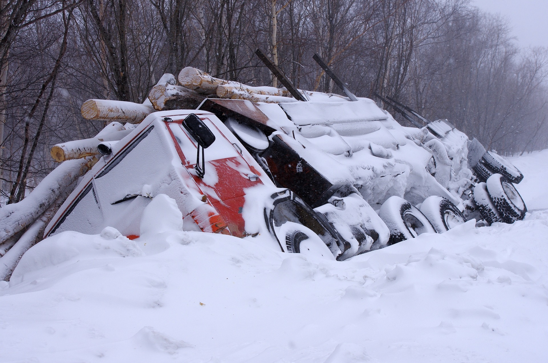 crashed truck covered in snow